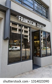GREENSBORO, NC, USA-2/14/19: The storefront of the Franciscan Center, which seeks to provide a Christian presence and witness to the community, reflecting Catholic and Franciscan traditions.