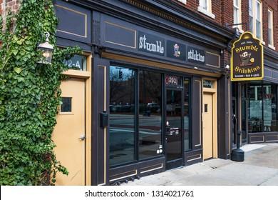 GREENSBORO, NC, USA-2/14/19: The storefront of Stumble Stilskins Tavern, Bar & Grill on W. Market St.