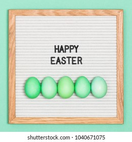 Green-themed Easter. Letter board with Easter eggs saying Happy Easter.
