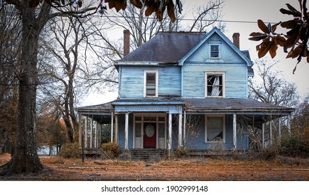 Greenville, Mississippi United States - January 2 2021: an old blue clapboard house on the corner