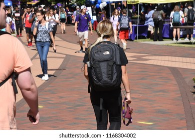 Greenville, NC/United States- 08/29/2018: A blonde female walks through campus on her way back from class.