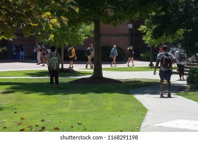 Greenville, NC/United States- 08/29/2018: Students at ECU walk across campus on a humid summer morning.