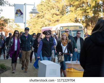 Greenville, NC/United States- 10/03/2016: ECU football supporters make the trek towards Dowdy Ficklen Stadium to watch the Pirates take on Tulane.