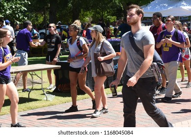 Greenville, North Carolina/United States- 08/30/2018: College students participate in a career fair on campus on a humid summer day.