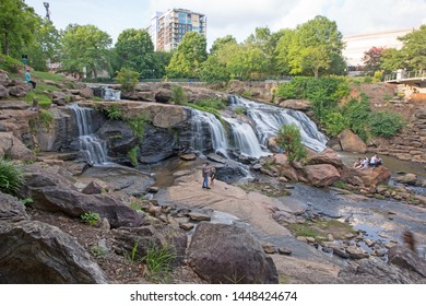 GREENVILLE, SC (USA) - July 5, 2019: The Reedy River Falls in Falls Park as viewed from a pedistrian walkway.