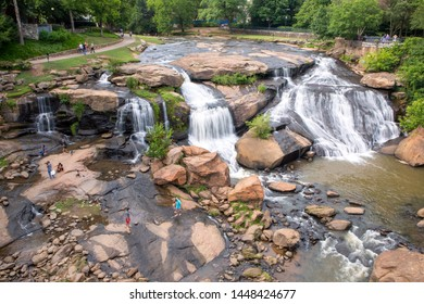 GREENVILLE, SC (USA) - July 5, 2019: A view of the Reedy River Falls in Falls Park viewed from the Liberty Bridge.