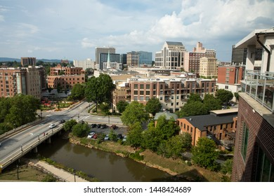 GREENVILLE, SC (USA) - July 5, 2019: A rooftop view of the Greenville skyline with the Reedy River at bottom.