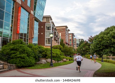 GREENVILLE, SC (USA) - July 5, 2019: A view of the downtown River Walk along the Reedy River and the River Place development of shops and restaurants.