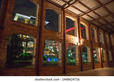 GREENVILLE, SC (USA) - July 5, 2019:  View of the River Place development of hotels, shops and restaurants as seen through the Wyche Pavilion along the River Walk.