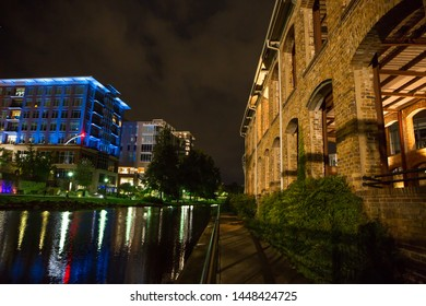 GREENVILLE, SC (USA) - July 5, 2019:  A view of the River Walk and River Place development of shops, restaurants and hotels with the Wyche Pavilion at right.