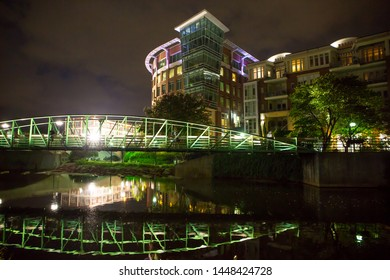 GREENVILLE, SC (USA) - July 5, 2019: A night-time view of the downtown River Walk with the River Place development of hotels, restaurants and shops.