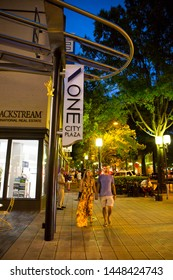 GREENVILLE, SC (USA) - July 5, 2019:  People enjoying a warm summer night among the shops and restaurants of downtown Greenville.