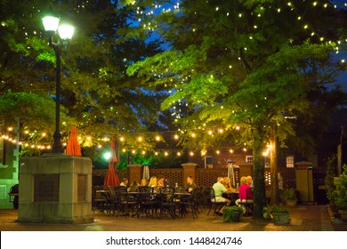 GREENVILLE, SC (USA) - July 5, 2019:  People eating at an outdoor cafe after dark in downtown Greenville.