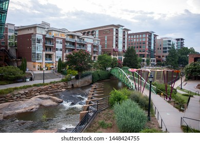 GREENVILLE, SC (USA) - July 5, 2019:  A view of the downtown River Walk with the River Place development of hotels, restaurants and shops.