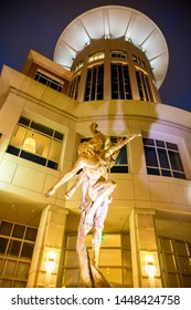 GREENVILLE, SC (USA) - July 5, 2019:  A night-time view of the downtown 210 S. Main Street building with sculpture in front.