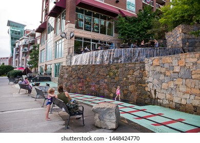 GREENVILLE, SC (USA) - July 5, 2019: A view of the downtown River Walk with the River Place development of hotels and shops.