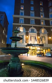 GREENVILLE, SC (USA) - July 5, 2019:  An after-dark view of the downtown Westin hotel with a fountain in the foreground.