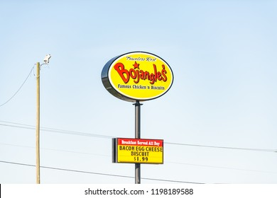 Greenville, USA - April 20, 2018: Bojangles large colorful sign on highway road isolated against blue sky fast food fried chicken and biscuits breakfast restaurant in South Carolina