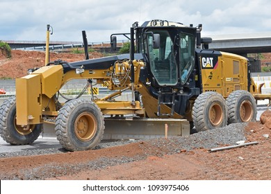 Greenville,SC/USA-May 18 2018:A motor grader is parked on a highway construction project after rain stopped work for a few days in SC/USA on May 28 2018.