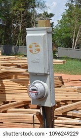 Greenville,SC/USA-May 20 2018:A temporary electric power pole with cutoff and utility meter re shown in a new home construction site near Greenville SC USA on May 20 2018.