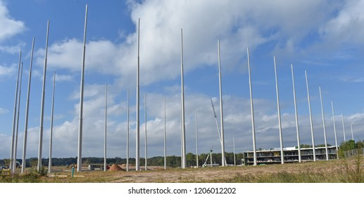 Greenville,SC/USA-October 15 2018-The netting support poles stand in a semi-circle at a new Topgolf facility under construction near Greenville SC USA on 10-15-2018. Opening is slated summer 2019.
