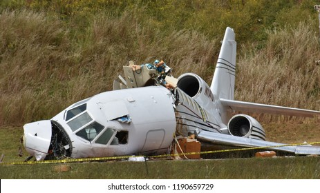 Greenville,SC/USA-September 28 2018: A private jet that crashed when it over-ran the runway at Greenville Downtown Airport on Thursday September 27 rests in Airport Road awaiting removal.