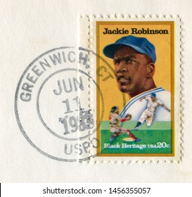Greenwich, Connecticut, The USA - 11 June 1983: Us historical stamp: Jackie Robinson was an American professional baseball player who became the first African American to play in Major League.