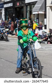 "Greenwich, CT, USA - March 22, 2015: The individual is one of the many participants in the  ""Annual St. Patrick's Day"" parade held on March 22, 2015 in downtown Greenwich Connecticut."
