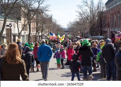 "Greenwich, CT, USA - March 22, 2015: Spectators enjoying the  ""Annual St. Patrick's Day"" parade held on March 22, 2015 in downtown Greenwich Connecticut."