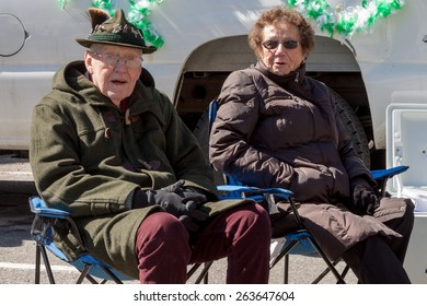 """Greenwich, CT, USA - March 22, 2015: Spectators enjoying the  """"Annual St. Patrick's Day"""" parade held on March 22, 2015 in downtown Greenwich Connecticut."""