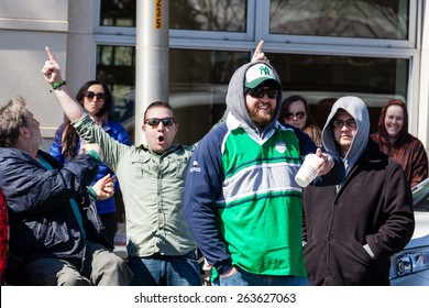 """Greenwich, CT, USA - March 22nd, 2015: Spectators enjoying the  """"Annual St. Patrick's Day"""" parade held on March 22nd, 2015 in downtown Greenwich Connecticut."""