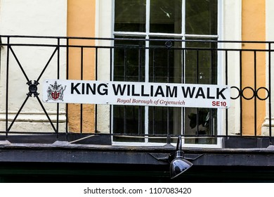 GREENWICH, UK - JUNE 9, 2015: Street sign on brick wall marking Greenwich's famous King William Walk street. The local council responsible for King William Walk street is Royal Borough of Greenwich