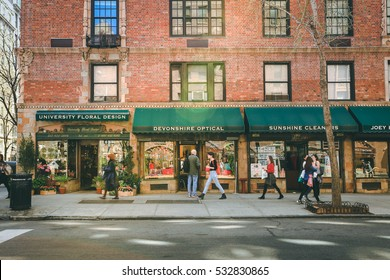 Greenwich village, New York City - April 21, 2016 : Street scene in Greenwich Village with  sun flare on building