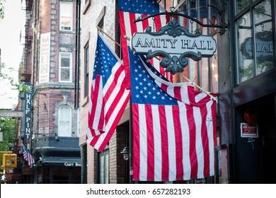 GREENWICH VILLAGE, NEW YORK CITY May 10 2017, American flags hanging outside of Amity Hall bar and restaurant in downtown Manhattan