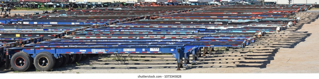 Greer,SC/USA-April 20 2018: Empty intermodal highway trailer chassis sit in a chassis pool at Inland Port Greer in Greer SC on April 20, 2018 waiting for containers.