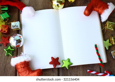Greeting, Blank Notebook With Christmas decoration on wooden Background