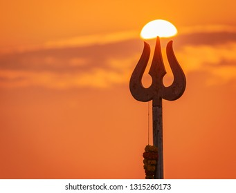 Greeting card background  with trishula for Maha Shivratri, a Hindu festival celebrated of Shiva Lord. Trident of lord shiva in Goa India