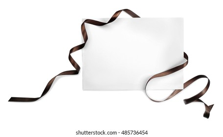 Greeting card with beautiful ribbon on white background