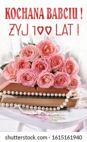 greeting card with bunch of pink roses and text in polish language Dear Grandma live 100 years