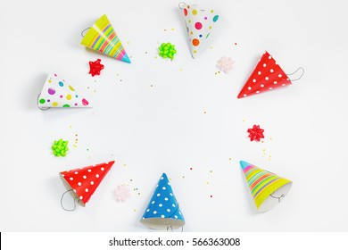 Greeting card for carnival party. Party hat and confetti on light background.