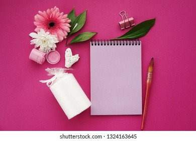 Greeting card concept.Flowers on bright pink background