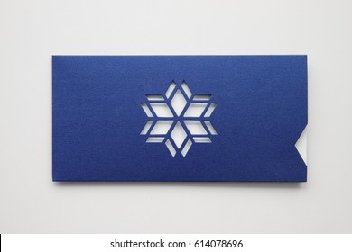 Greeting card design mock up, envelope from design paper with star or snowflake die-cut , isolated on white background, close up