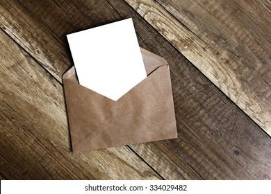 greeting card. empty blank card and envelope on old wooden background