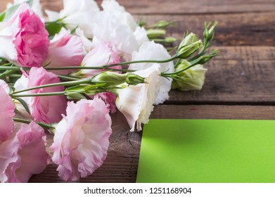Greeting card with flowers Lisianthus, eustoma in rustic style. Mothers day