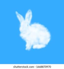 Greeting card from fluffy Easter rabbit made from white cloud on a pastel sky blue background with copy space. Festive Happy Easter card.
