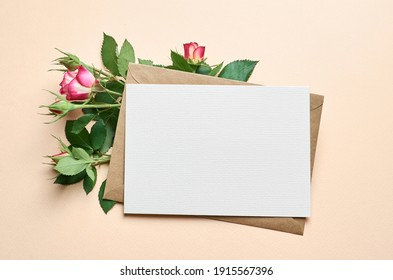 Greeting card with fresh roses flowers frame on paper background, card mockup with copy space
