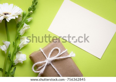 Greeting card idea paper note surrounded stock photo edit now greeting card idea with a paper note surrounded by white flowers and a gift box wrapped m4hsunfo
