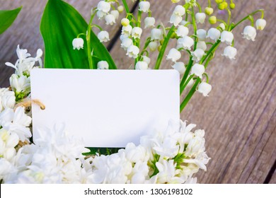 Greeting card with lily of the valley and lilac