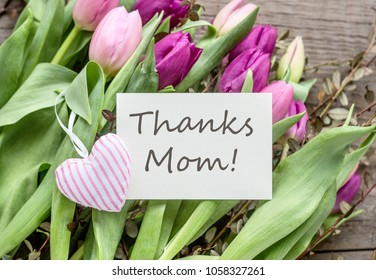 Greeting card for Mother's Day with pink and violet tulips and heart