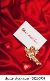 Greeting card on red silk satin.